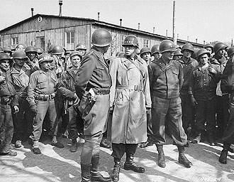file:/activities/oralhistory/cappics/cohen1945_generals, alt: General George S. Patton and General Omar Bradley surrounded by soldiers