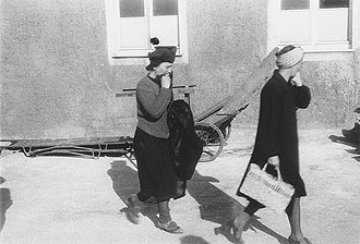 file:/activities/oralhistory/cappics/cohen1945_women, alt: Two German women leaving the Buchenwald concentration camp