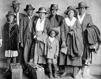 file:/activities/oralhistory/cappics/loving1914_migration, alt: family of eight with suitcases