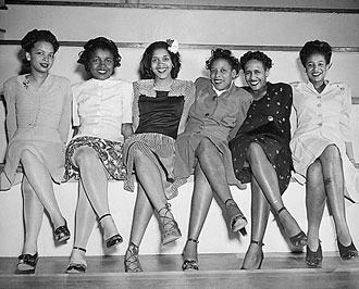file:/activities/oralhistory/cappics/loving1941_6women, alt: Six young women seated in a line with legs crossed