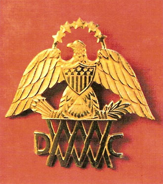 file:/activities/oralhistory/cappics/loving1941_insignia, alt: gold eagle pin for the Mass Women's Defense Corp