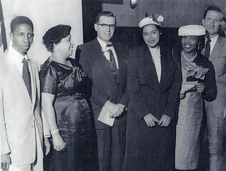 file:/activities/oralhistory/cappics/loving1945_rosa, alt: Rosa Parks stands with Ruth Loving and four other people.