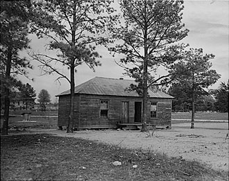 file:/activities/oralhistory/cappics/pryor1934_schoolhouse, alt: B/W photo of one-room schoolhouse