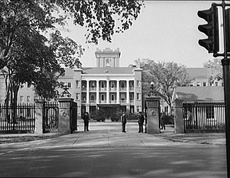 file:/activities/oralhistory/cappics/pryor1941_armory, alt: B/W photo of main entrance to armory building