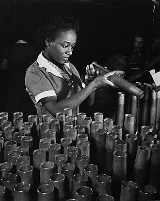 file:/activities/oralhistory/cappics/pryor1941_bertha, alt: woman inspecting metal artillery casings