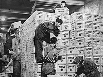 file:/activities/oralhistory/cappics/slater1924_gunpowder, alt: workers stacking cases of gunpowder