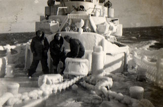 file:/activities/oralhistory/cappics/slater1942_life_ice, alt: 3 crew members aboard a snow encrusted USS Walter S. Brown
